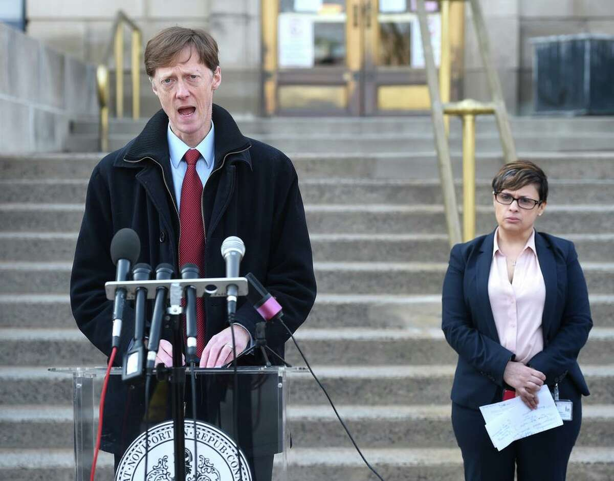 New Haven Mayor Justin Elicker holds a press briefing outside of the Hall of Records in New Haven on March 20, 2020. At right is New Haven Director of Health Maritza Bond.