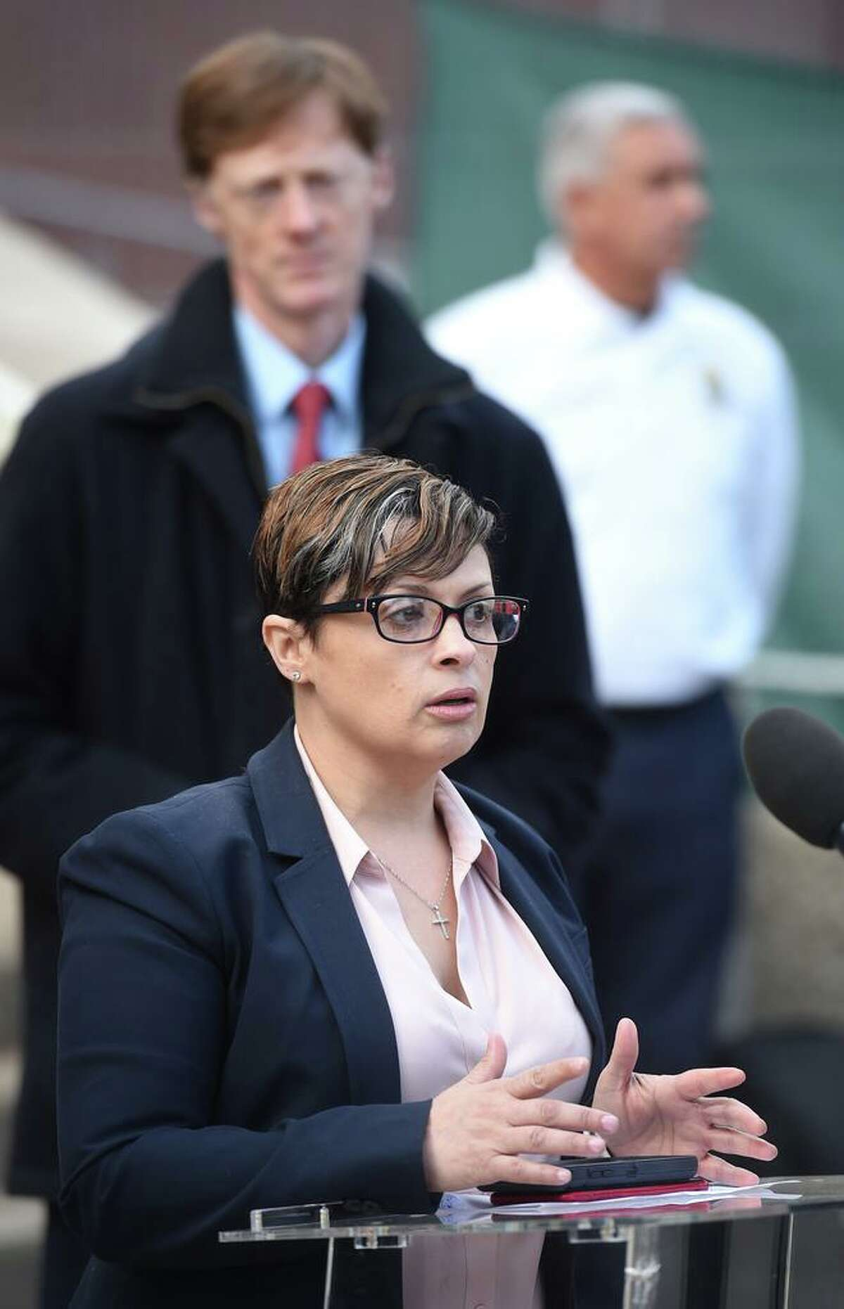 Maritza Bond, New Haven Director of Health, answers questions during a press briefing outside of the Hall of Records in New Haven on March 20, 2020. Behind her is New Haven Mayor Justin Elicker.