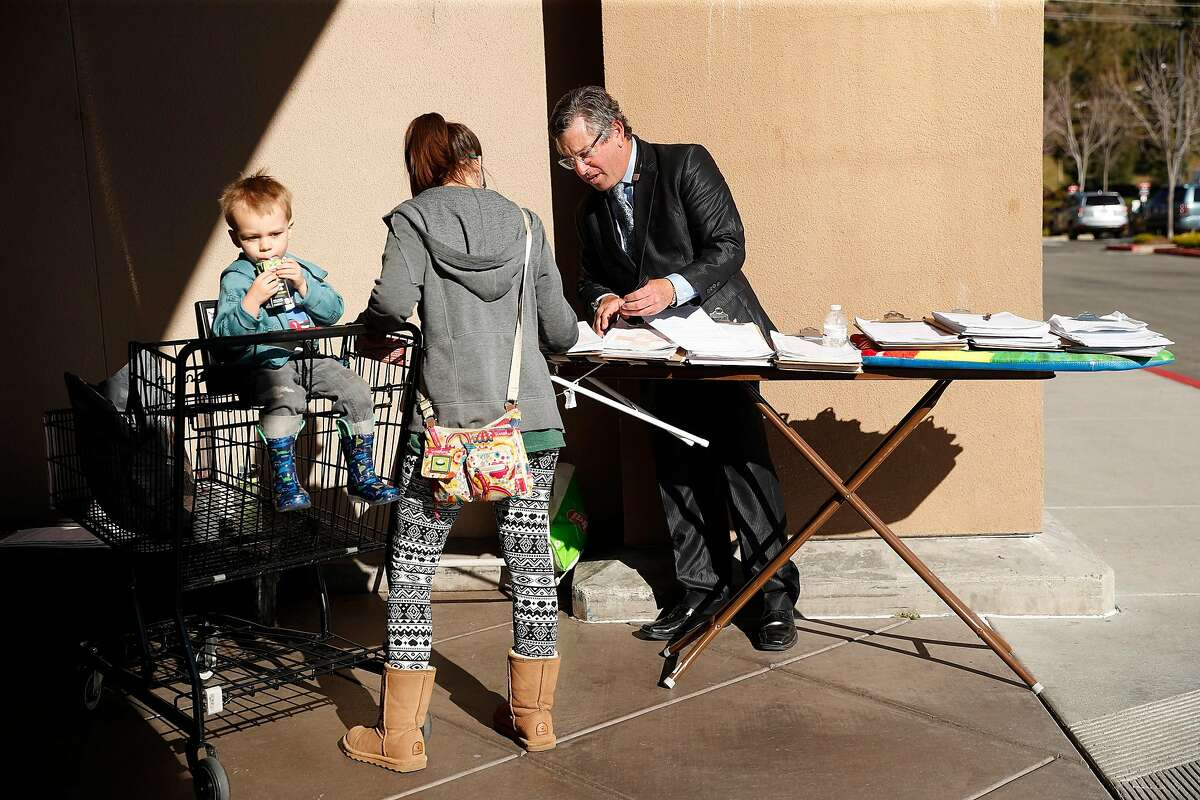 Collecting signatures outside of a Safeway grocery store in Novato, Calif., on Wednesday, February 5, 2020.