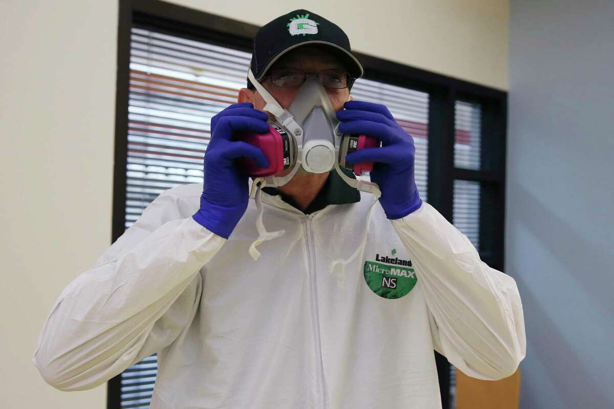 Josh White, with Austin-based GermLogic, prepares to sterilize the Carmen P. Cortez Avance Family Center on South San Jacinto Street on Friday. Disinfecting and cleaning companies such as GermLogic have seen a high demand for their services due to coronavirus concerns.