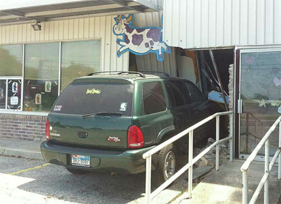 A woman dropping her children off at a North Side daycare center Wednesday morning crashed into the building after her brakes failed, San Antonio police said.