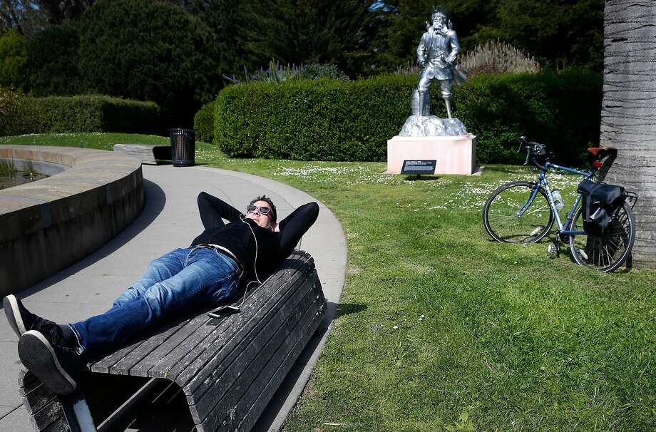 Josh Salafsky rests on a bench in the sculpture garden of the de Young Museum during a bike ride through Golden Gate Park amid the coronavirus pandemic in San Francisco. Photo: Paul Chinn / The Chronicle