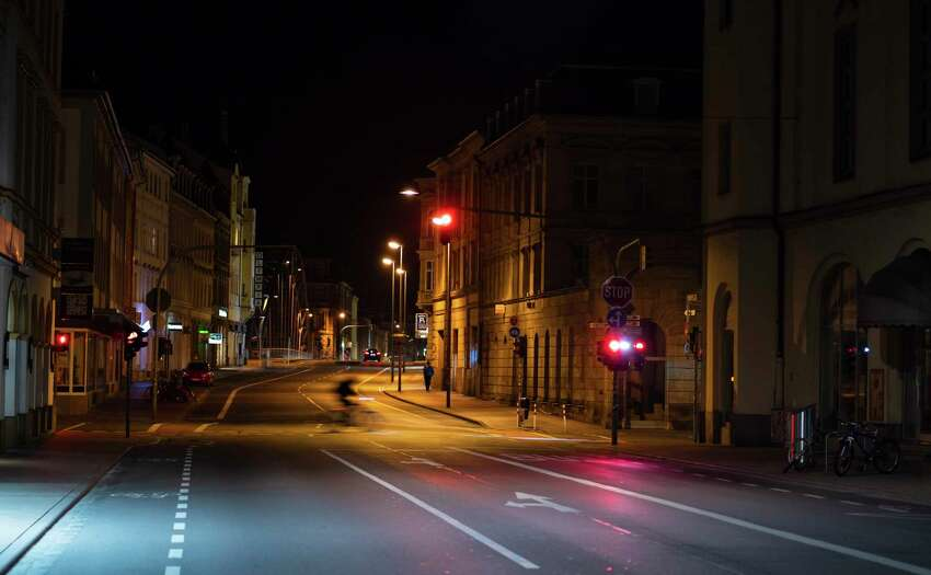 Luitpold Street in Bamberg, Germany, is seen shortly after the initial restriction imposed due to the spread of the coronavirus came into force, early Saturday, March 21, 2020. A curfew went into effect for Bavaria. Leaving one's own home is now only allowed if there are good reasons. (Nicolas Armer/dpa via AP)