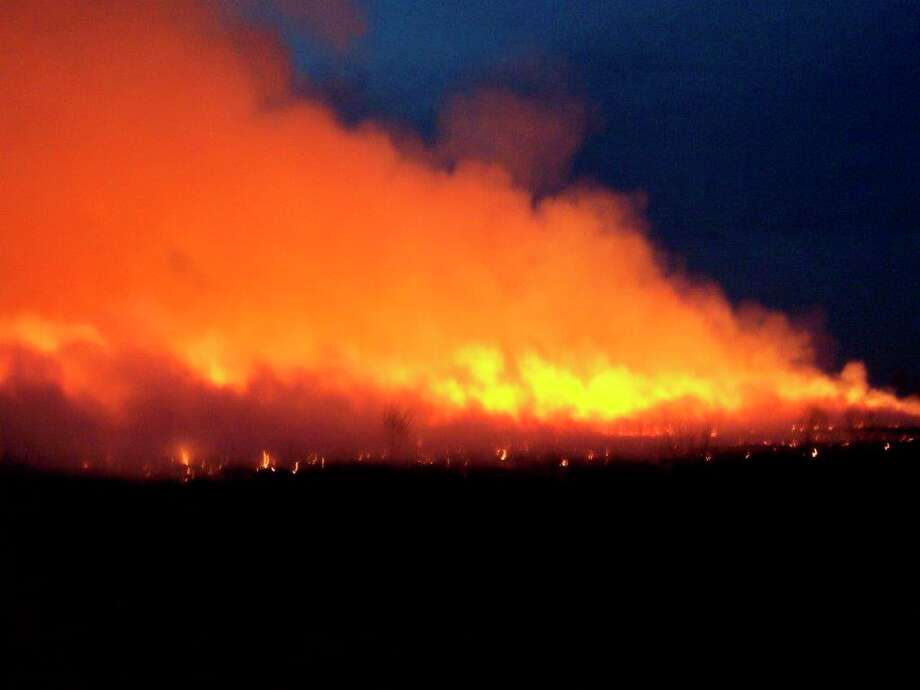 A swirling inferno marks the finale of a controlled burn in a prairie grass field. (Tom Lounsbury/Hearst Michigan)