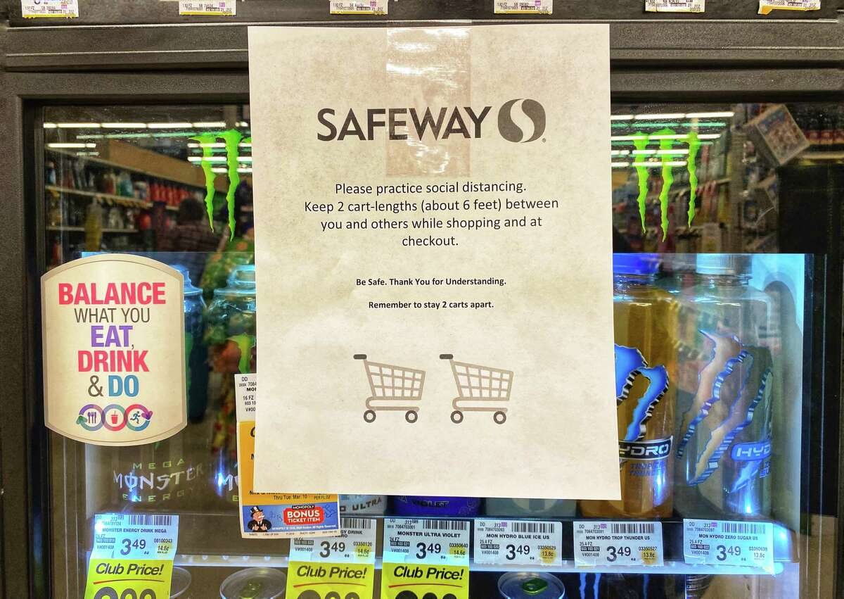 A sign inside a Safeway store in Willcox, Ariz., urging social distancing.
