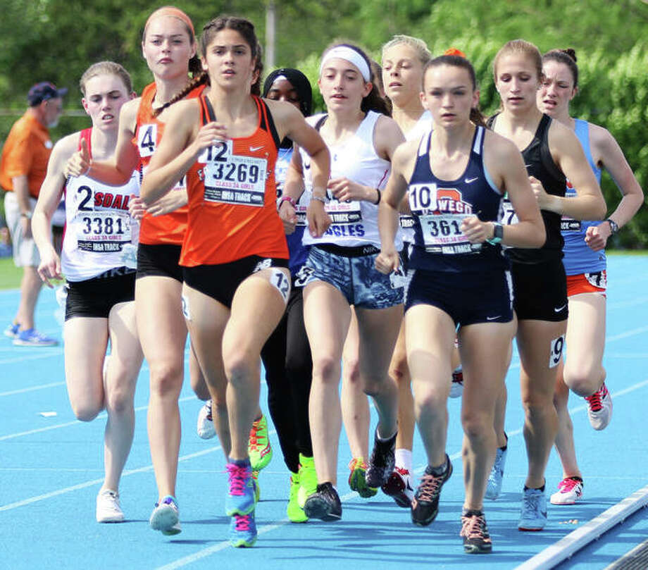 Edwardsville's Abby Korak (middle/12) leads a pack trailing the leaders in the 1,600-meter run at last season's Class 3A state meet at O'Brien Stadium in Charleston. Korak placed eighth to become the Tigers' first state medalist in the event. Photo: Greg Shashack / The Telegraph