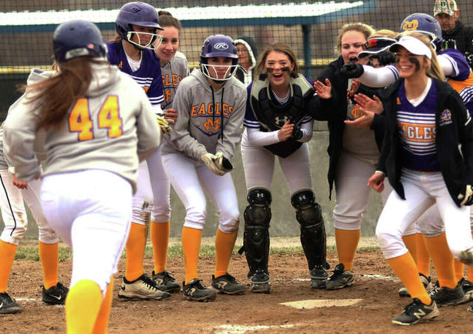 CM's Gracie Braun (44) approaches the plate mostly surrounded by teammates after her home run in a game against Roxana last March at the Bethalto Sports Complex. Photo: Greg Shashack / The Telegraph