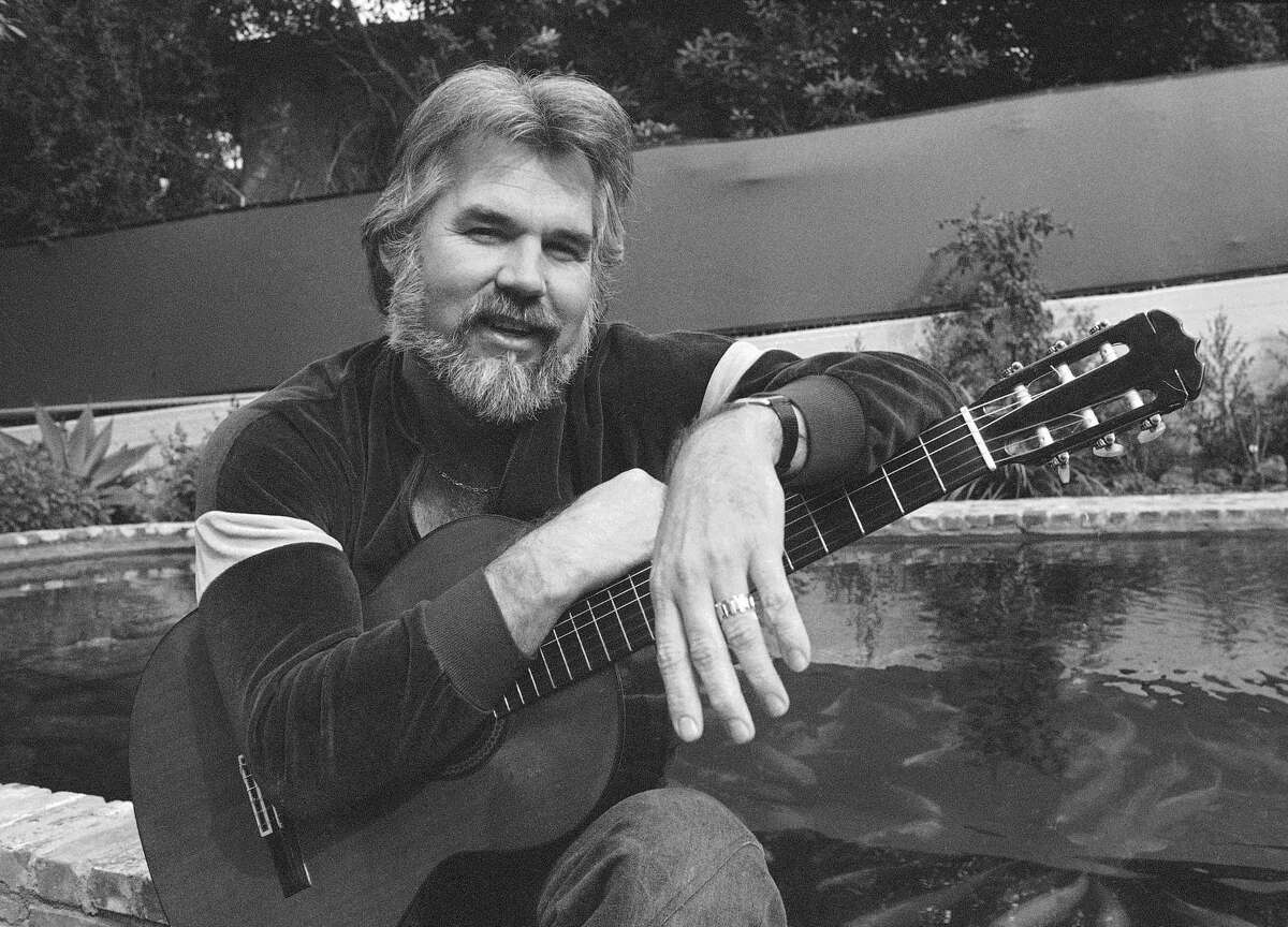 """FILE - This Feb. 20, 1978 file photo shows Kenny Rogers at his home in Brentwood, Calif. Rogers, who embodied """"The Gambler"""" persona and whose musical career spanned jazz, folk, country and pop, has died at 81. A representative says Rogers died at home in Georgia on Friday, March 20, 2020. (AP Photo/Wally Fong, File)"""