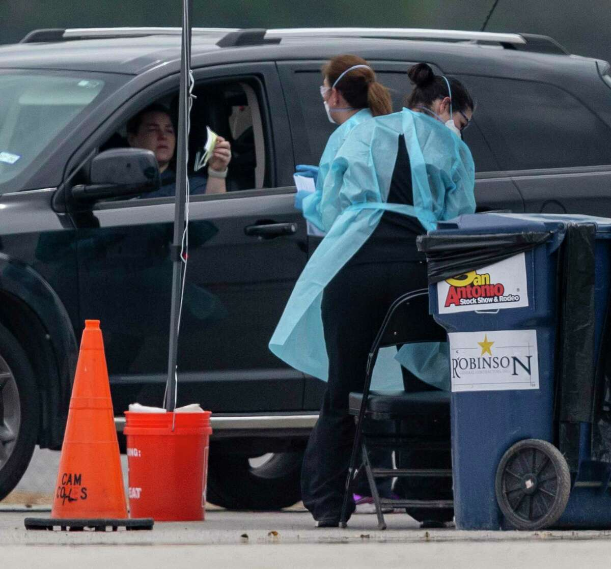 A person checks in Thursday, March 19,, 2020, at the Freeman Coliseum drive through COVID-19 coronavirus testing location. For more information on testing locations and hours of operation in the San Antonio area, call 311.