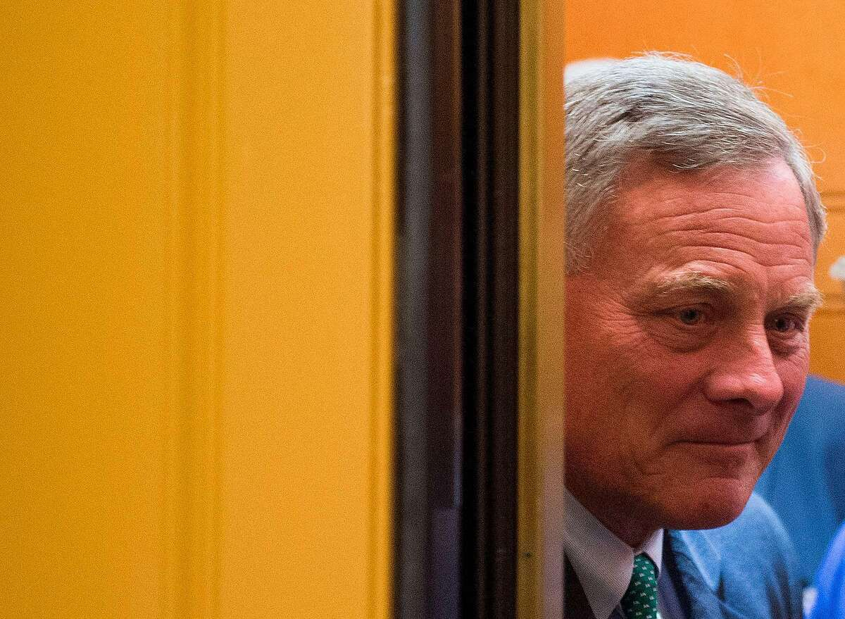 (FILES) In this file photo taken on July 17, 2018 Senator Richard Burr (R-NC) smiles at reporters as he walks to the chamber to go for a vote on Capitol Hill in Washington, DC. - Senate Intelligence Committee Chairman Richard Burr (R-N.C.), sold a significant share of his stocks last month, according to public disclosures on March 19, 2020. Burr reportedly was receiving daily briefings on the threat of the virus. In mid-February, he sold 33 stocks held by him and his spouse, estimated at between $628,033 and $1.72 million, Senate financial disclosures show. (Photo by ANDREW CABALLERO-REYNOLDS / AFP) (Photo by ANDREW CABALLERO-REYNOLDS/AFP via Getty Images)