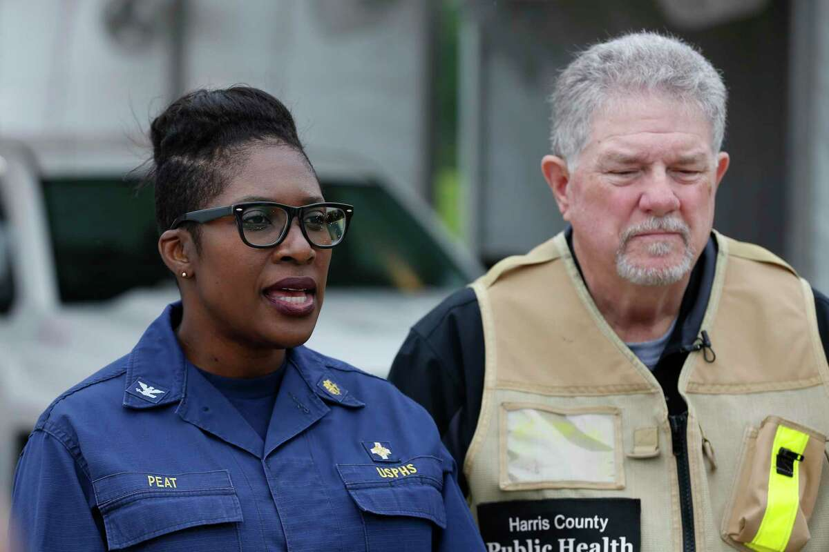 Capt. Raquel A. Peat of the U.S. Public Health Service and Harris County's Mac McClendon brief the media Saturday at the Baytown site.