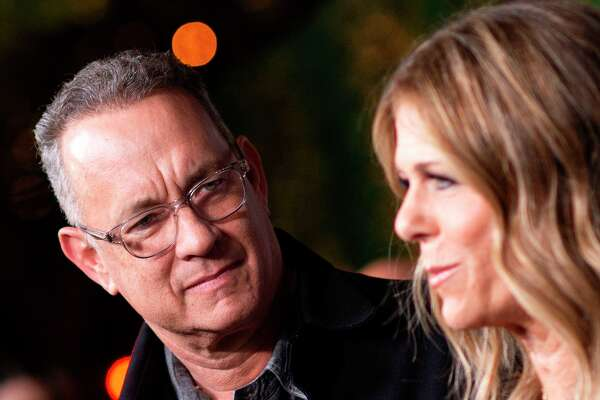 """In this file photo Actors Tom Hanks (left) and his wife actress/singer Rita Wilson attend """"JONI 75: A Birthday Celebration"""" Live at the Dorothy Chandler Pavilion in Los Angeles on November 7, 2018. - Tom Hanks and his wife Rita Wilson have both tested positive for coronavirus."""