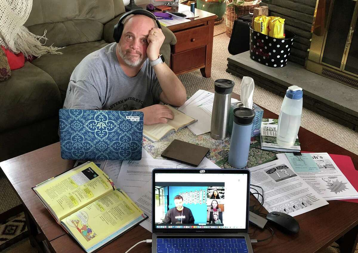 Middle school teacher Robert Walsh works from his home this week.