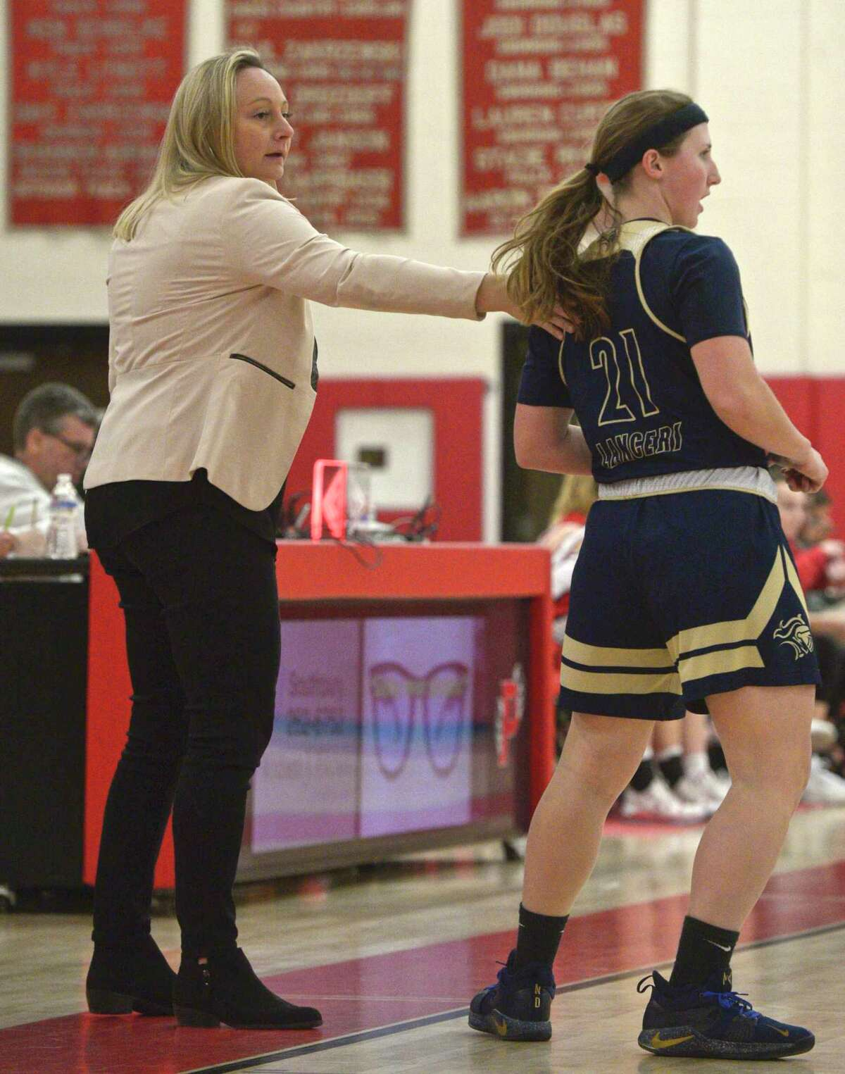 Coach Maria Conlon, left, and the Notre Dame-Fairfield girls basketball team rolled through the season without a loss against in-state competition.