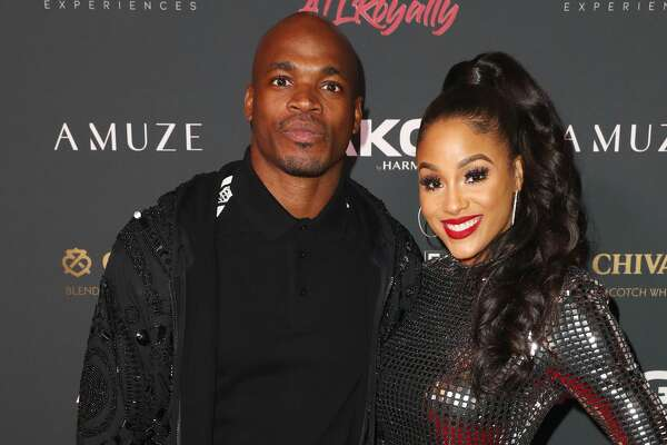 Adrian Peterson (L) and Ashley Brown Peterson attend The Maxim Big Game Experience at The Fairmont on February 02, 2019 in Atlanta, Georgia. (Photo by Joe Scarnici/Getty Images for Maxim)