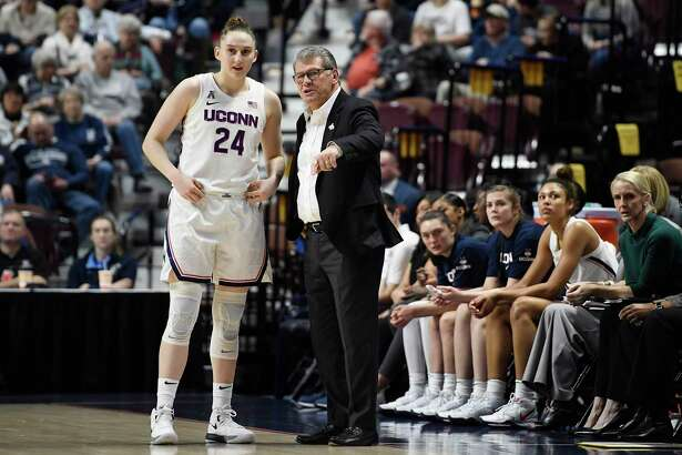 Connecticut head coach Geno Auriemma talks with Connecticut's Anna Makurat (24) in the first half of an NCAA college basketball game in the American Athletic Conference tournament quarterfinals at Mohegan Sun Arena, Saturday, March 7, 2020, in Uncasville, Conn. (AP Photo/Jessica Hill)