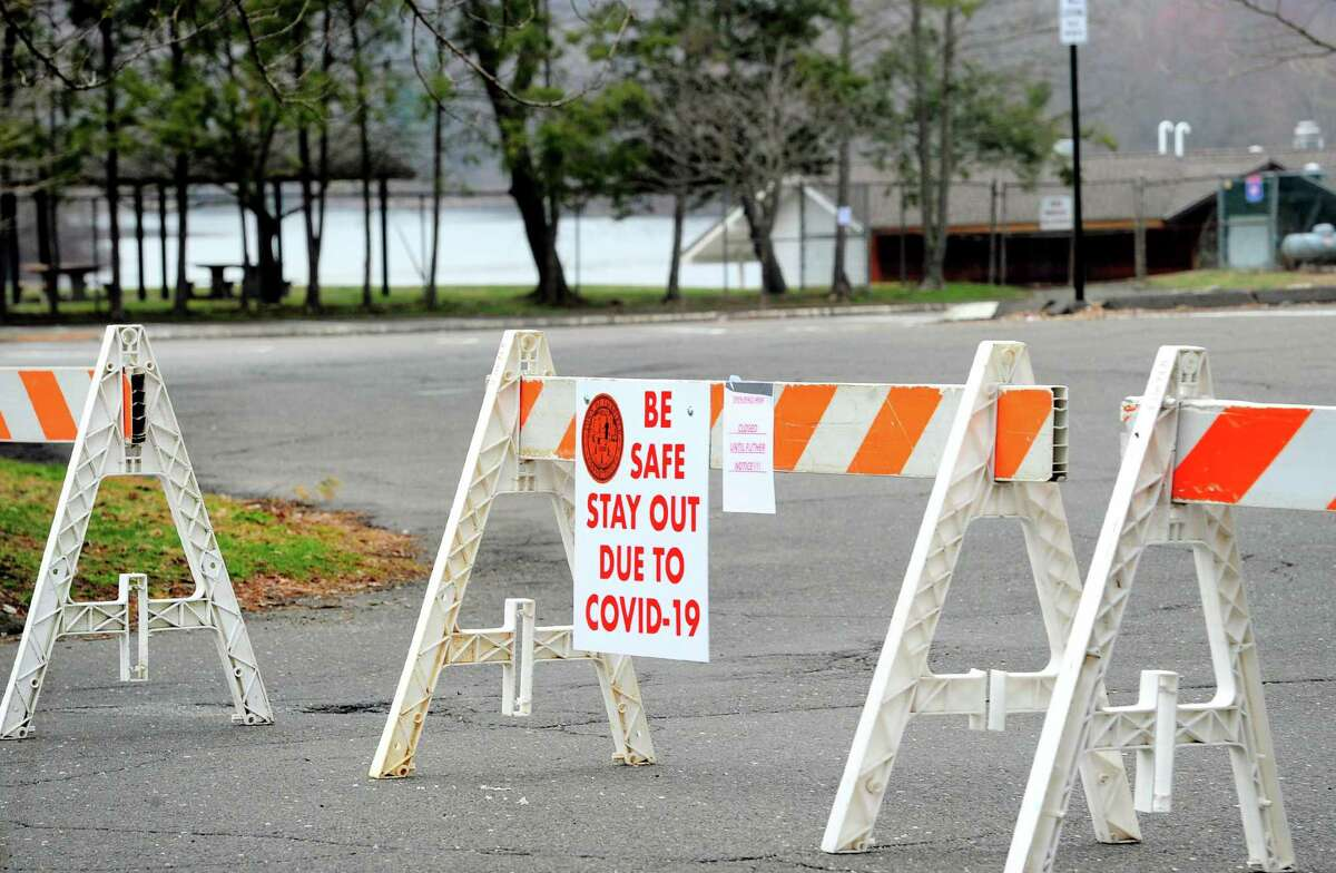 Barriers block vehicles from parking at Lake Mohegan in Fairfield on Friday. The town has closed down all beaches and parks to mitigate the effects of the coronavirus.