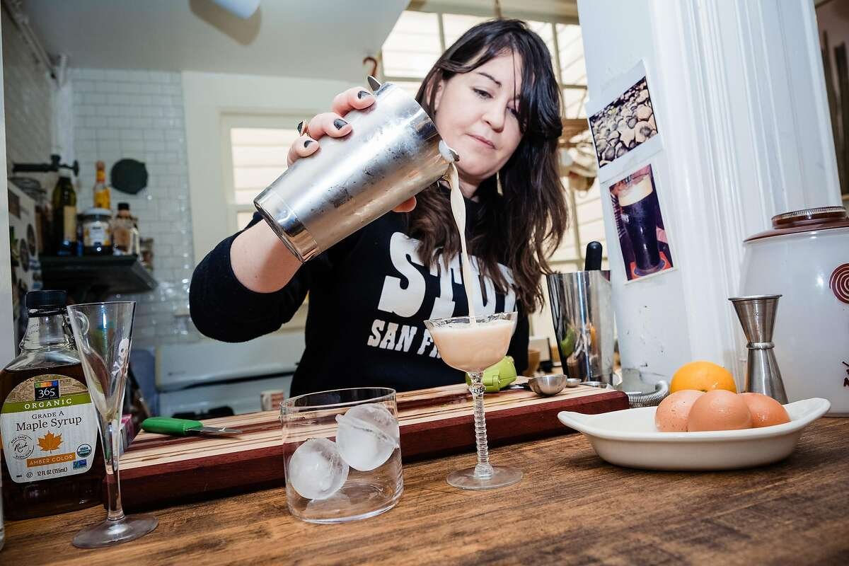 Gillian Fitzgerald a bartender and co owner of a bar in the Mission makes a slow gin sour at her home San Francisco, Calif. on Friday, March 20, 2020. Fitzgerald has been hosting a live stream to teach people how to make cocktails.