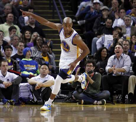 Jarrett Jack (2) reacts after scoring in the second half. The Golden State Warriors played the Los Angeles Lakers at Oracle Arena in Oakland, Calif., on Monday, March 25, 2013.
