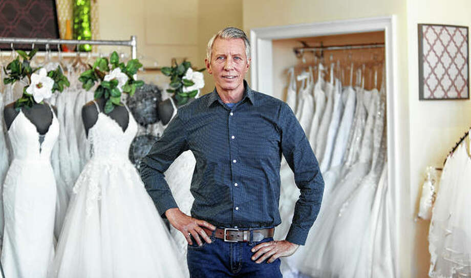 "David Gaffke, owner of the bridal salon Complete Bridal, stands Feb. 28 in his shop in East Dundee. He is heavily reliant on China for manufacturing. ""It's frustrating when it comes to having to tell a bride that we're not able to fulfill your needs,"" he said. ""This is the most important dress they're going to wear."" Photo: Teresa Crawford 