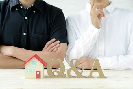 Man and woman thinking about housing