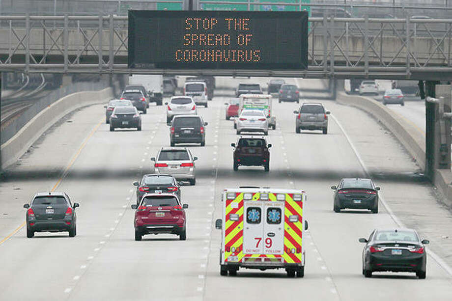A traffic board displays a message about coronavirus prevention. Photo: Charles Rex Arbogast   AP