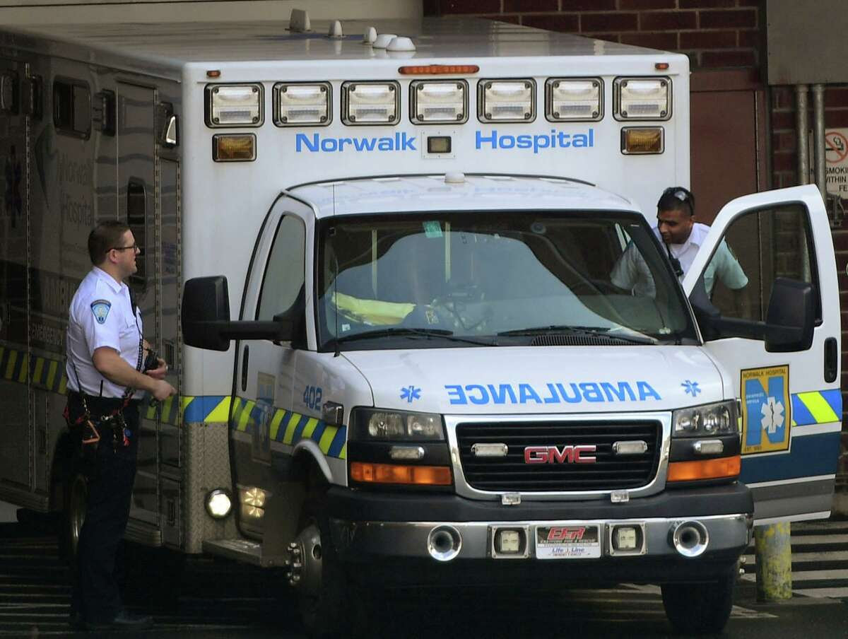 Norwalk Hospital EMS respond to a call last week amid the coronavirus outbreak.