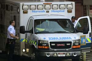Norwalk Hospital EMS respond to a call last week amid the coronavirus outbreak.