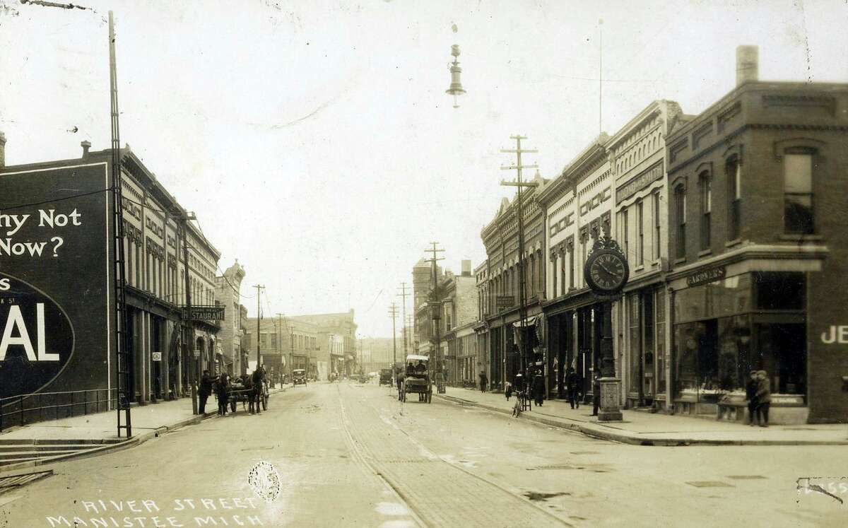 A view of River Street in 1915 looking east from the corner of Oak Street. Three years later, Manistee and the rest of the country would be in midst of World War I and the Spanish Flu.(Courtesy art/Manistee County Historical Museum)