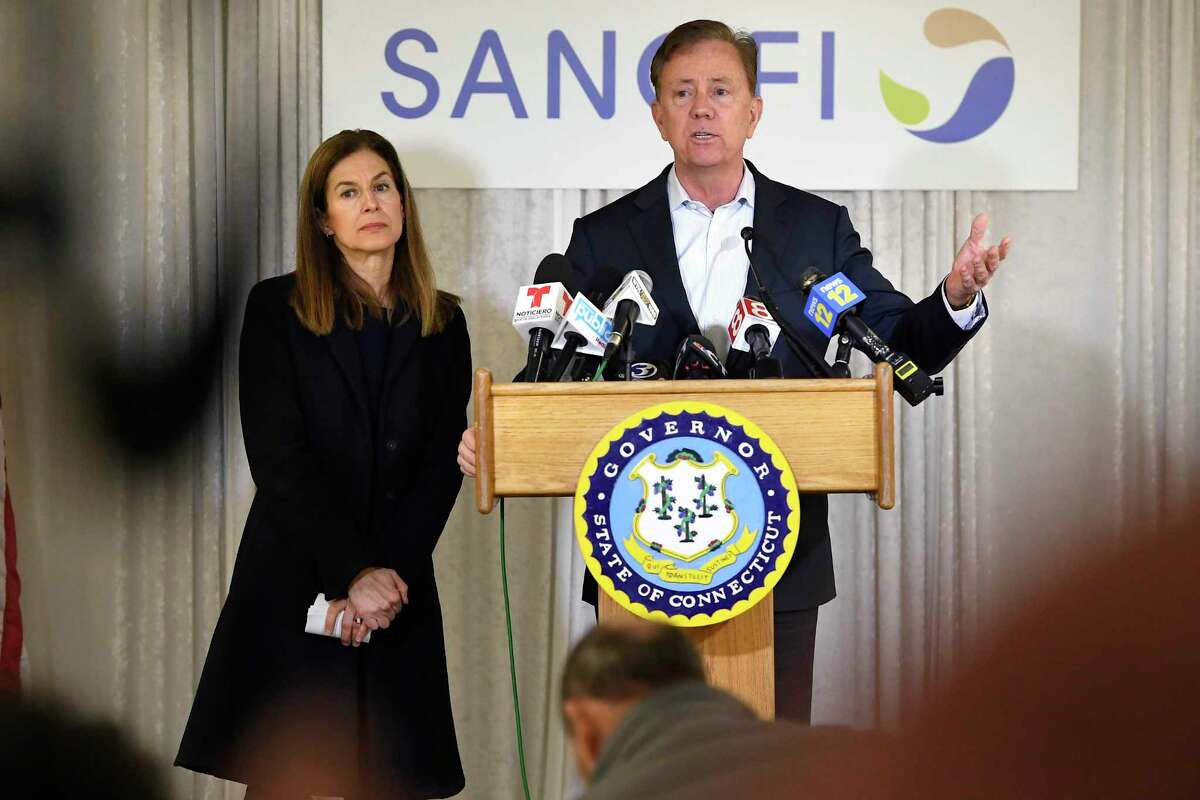 Connecticut Gov. Ned Lamont, right, speaks to the media as Lt. Gov. Susan Bysiewicz, left, looks on, during a visit to Protein Sciences, Thursday, March 12, 2020, in Meriden, Conn.