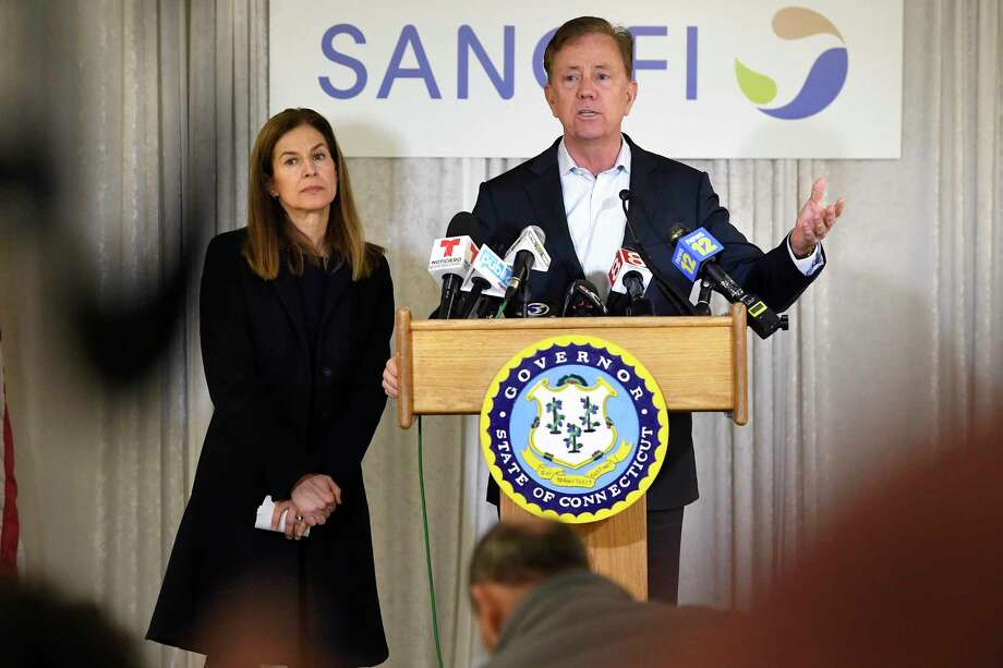 Connecticut Gov. Ned Lamont, right, speaks to the media as Lt. Gov. Susan Bysiewicz, left, looks on, during a visit to Protein Sciences, Thursday, March 12, 2020, in Meriden, Conn. Photo: Jessica Hill / Associated Press / Copyright 2020 The Associated Press. All rights reserved.