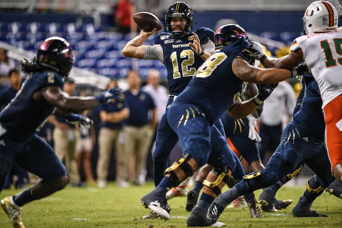 MIAMI, FLORIDA - NOVEMBER 23: James Morgan #12 of the FIU Golden Panthers looks to pass against the Miami Hurricanes in the second half at Marlins Park on November 23, 2019 in Miami, Florida. (Photo by Mark Brown/Getty Images)
