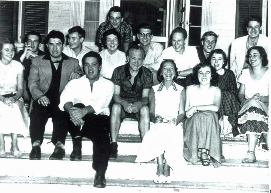 Stephen Sondheim (top of photo) was an apprentice at Westport Country Playhouse in 1950. Mary Rodgers, Richard Rodgers' daughter, was also an apprentice that year (second row, right). Here they are with actress Gertrude Lawrence (front row, white dress, checkered collar) in front of the Jolly Roger Restaurant on Post Road East, across the street from the Playhouse. Photo: Westport Country Playhouse / Contributed Photo