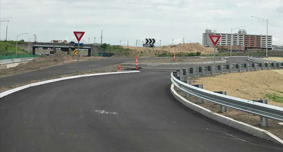 The view of what will be the new entrance to Bradley International Airport from Route 20. When the roadwork is completed this fall, there will be a roundabout (shown in foreground) at the entrance designed to reduce the speed of traffic as it enters the airport grounds. The current entrance from Route 20 is shown at left and the airport's Sheraton Hotel can be seen in the background. Photo: Luther Turmelle / Hearst Connecticut Media