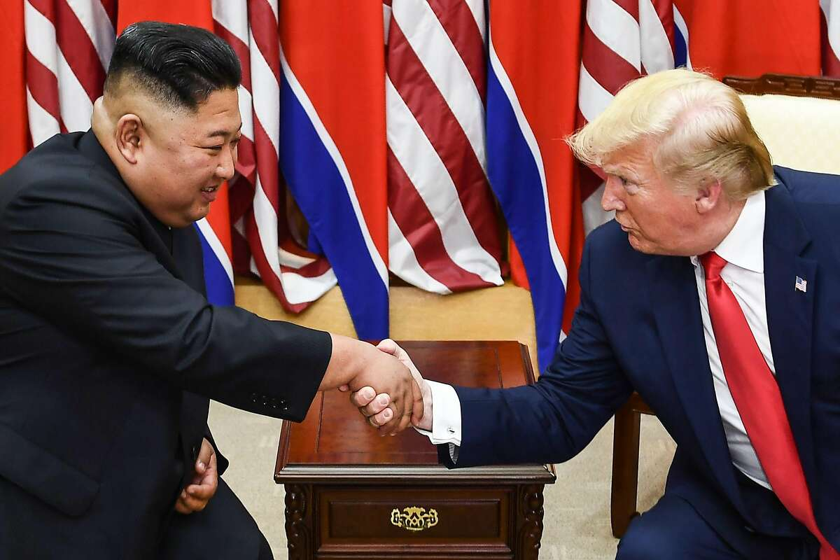 (FILES) In this file photo taken on June 30, 2019, North Korea's leader Kim Jong Un (L) and US President Donald Trump shake hands during a meeting on the south side of the Military Demarcation Line that divides North and South Korea, in the Joint Security Area (JSA) of Panmunjom in the Demilitarized zone (DMZ). - US President Donald Trump has sent a letter to North Korean leader Kim Jong Un detailing a plan to develop ties, state media reported on March 22, 2020, as a prolonged hiatus in disarmament talks with the United States drags on. (Photo by Brendan Smialowski / AFP) (Photo by BRENDAN SMIALOWSKI/AFP via Getty Images)