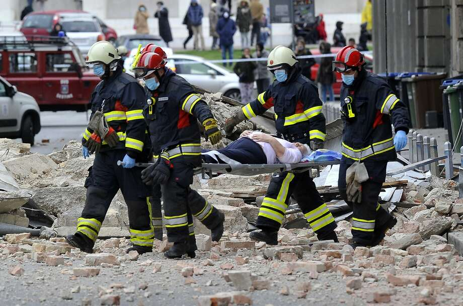 Firefighters carry a person on a stretcher after an earthquake. Prime Minister Andrej Plenkovic said the quake was the biggest in Zagreb in the last 140 years. Photo: Associated Press
