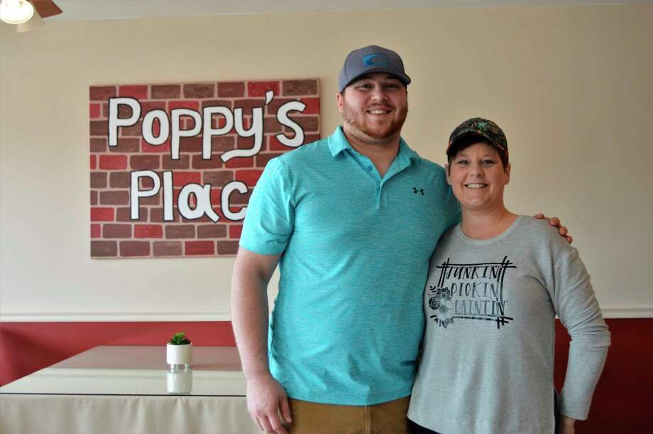 Jackson Brady with his mother Jamie Brady, pose for a photo at Jackson's new restaurant, Poppy's Place. Jamie used a back portion of the new space to set up her up-cycled treasure shop, Re-Cre8ted. (Ashley Schafer/Ashley.Schafer@hearstnp.com)