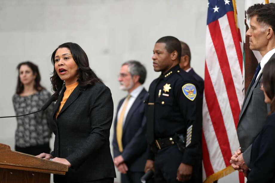 San Francisco Mayor London Breed (left) speaks during a press conference as San Francisco police chief William Scott (right) looks on at San Francisco City Hall on March 16, 2020 in San Francisco. Breed announced a shelter-in-place order for residents in San Francisco until April 7. The order will allow people to leave their homes to do essential tasks such as grocery shopping and pet walking. Photo: Justin Sullivan/Getty Images / 2020 Getty Images