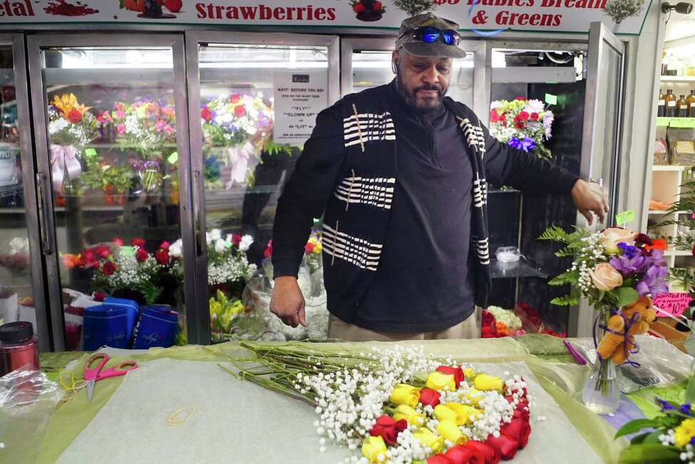 Mark Carter, owner of Taysha Florist, makes up a bouquet incase he gets a walk-in customer on Sunday, March 22, 2020, in Albany, N.Y. Carter said that on Saturday two funerals were canceled,