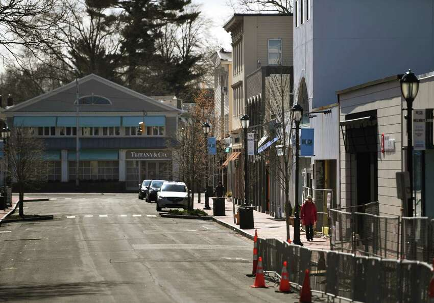 The downtown retail district is nearly deserted in wake of the coronavirus pandemic business in Westport, Conn. on Sunday, March 22, 2020.