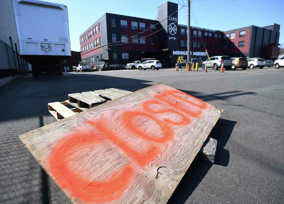 A large closed sign outside Monger's Market in Bridgeport. Gov. Lamont's executive order to close non-essential businesses goes into effect Monday. Photo: Brian A. Pounds / Hearst Connecticut Media / Connecticut Post