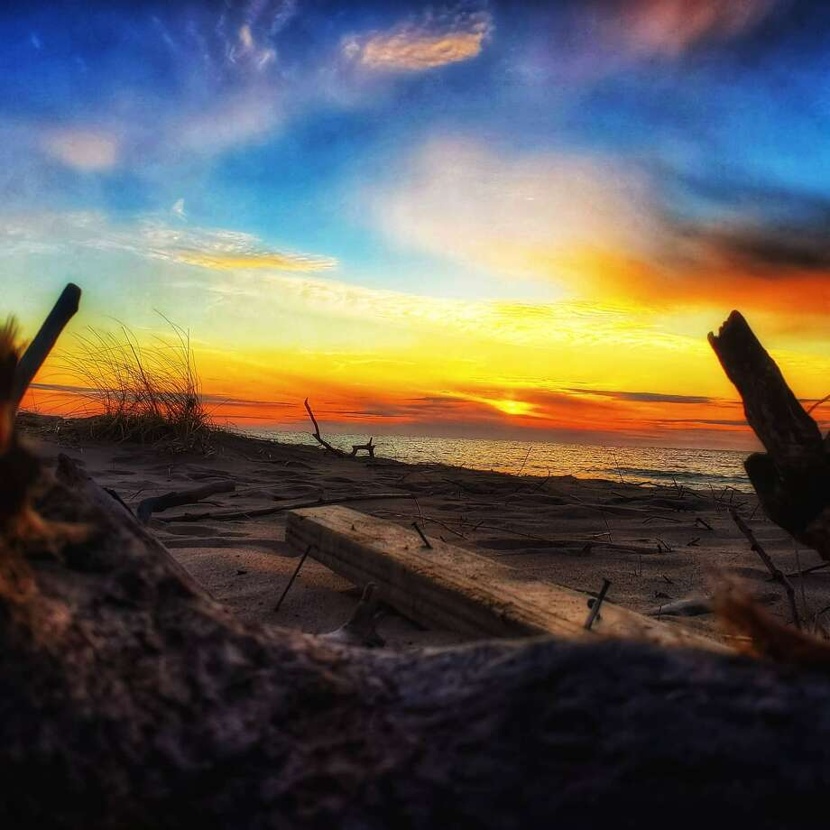 There are many things one can do to relieve stress or keep busy in Manistee County while practicing social distancing like watch a sunset. Photo: Paula Laws/News Advocate
