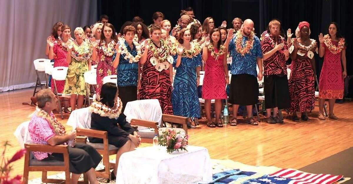 JaKyah Beatty, second from right in front line, swears as a Peace Corps volunteer with other people last October at The University of the South Pacific in Suva, Fiji. Beatty is quarantining in a hotel in Houston after 7,000 volunteers like her were forced to evacuate their posts abroad due to the COVID-19 worldwide epidemic.