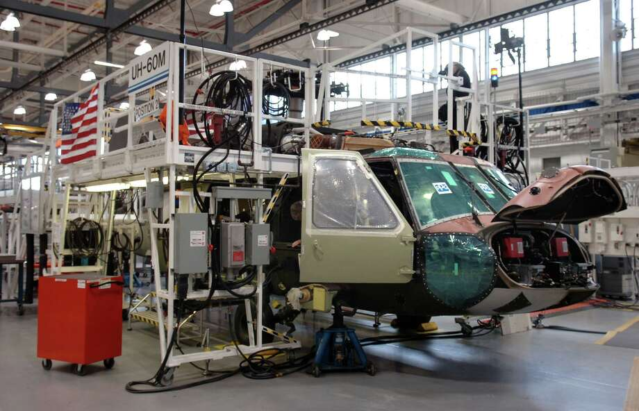 Defense contractors such as the Stratford-based Sikorsky Aircraft Division of Lockheed are allowed to keep working during the pandemic. Photo: Ned Gerard / ST / Connecticut Post
