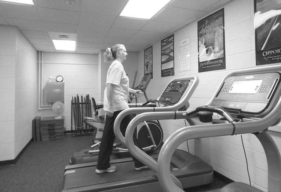 Laura Thomas walks on a treadmill in the new Julie A. Honerkamp Strong Survivors Cancer Rehabilitation Lab at Southern Illinois University. Photo: Marilyn Halstead | Southern Illinoisan (AP)