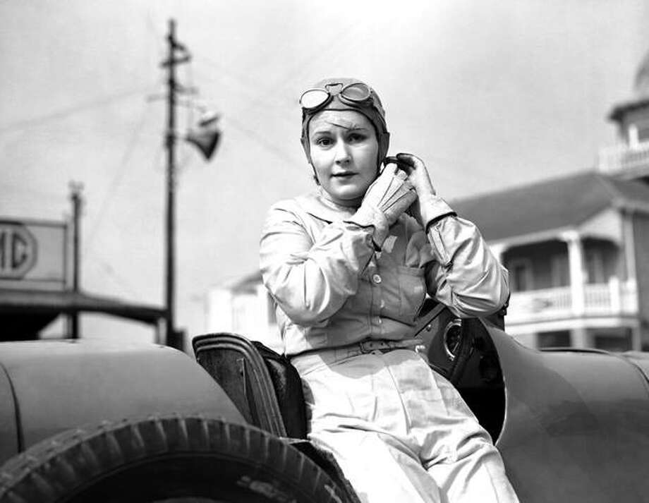 Kay Petre returned to the Brooklands racing track for the first time since her accident in September, when she appeared in a supercharged Riley car. Kay Petre adjusting her motoring helmet at Brooklands, England, on March 23, 1938. (AP Photo/Len Puttnam)