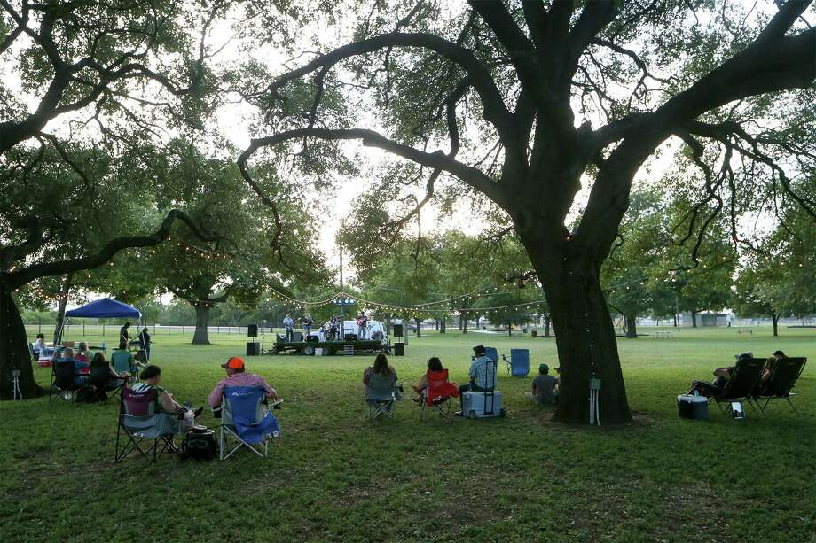 People enjoy live music at Pickrell Park in Schertz on a Friday afternoon in June 2019. Guadalupe County reported its second confirmed case of COVID-19 on Sunday and alerted area residents who were at the H-E-B Plus in Schertz near the corner of Interstate 35 and FM 3009 on March 16, between 11 a.m. and 2 p.m., that they may have been exposed to coronavirus. Photo: Marvin Pfeiffer /San Antonio Express-News / Express-News 2019
