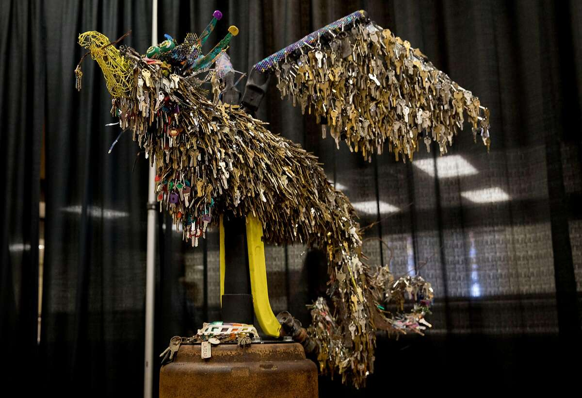 The Key Phoenix, a sculpture that includes 18,000 keys of various businesses, cars and other locks created by artist Jessie Mercer, is seen on display during the opening ceremony of the Building Resiliency Center and commemoration of the one year anniversary of the devastating Camp Fire in Paradise, Calif. Friday, Nov. 8, 2019.