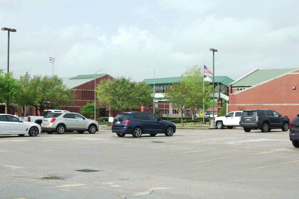 The parking lot at Lutheran South empties March 20 on a day when students had the opportunity to retrieve school supplies as the school prepared to move courses online.