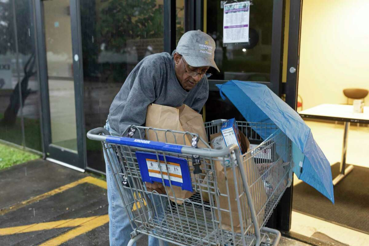 Gary P. Murray loads food into his vehicle after visiting the in Northwest Assistance Ministries Watford Nutrition Center Tomball, Friday, March 20, 2020. The food pantries biggest donors are Krogers and Walmart which have been assisting them with keeping the pantry in stock during the new coronavirus pandemic.